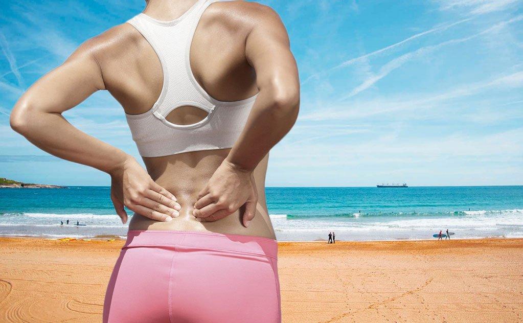 Carregar pesos como caixas térmicas e cadeiras de praia podem causar dores e lesões na coluna